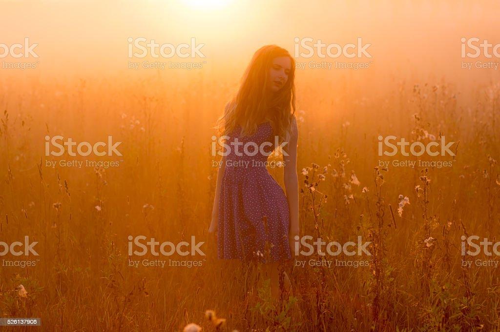 Beautiful girl in fog stock photo