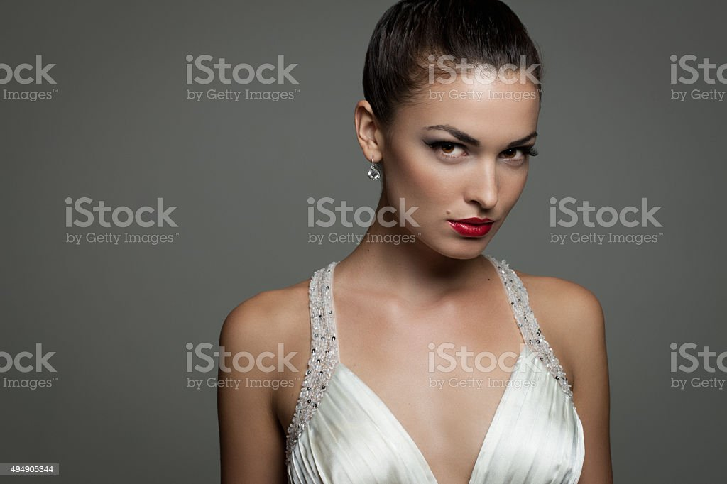 Beautiful Girl in Gown and Diamond Earrings stock photo
