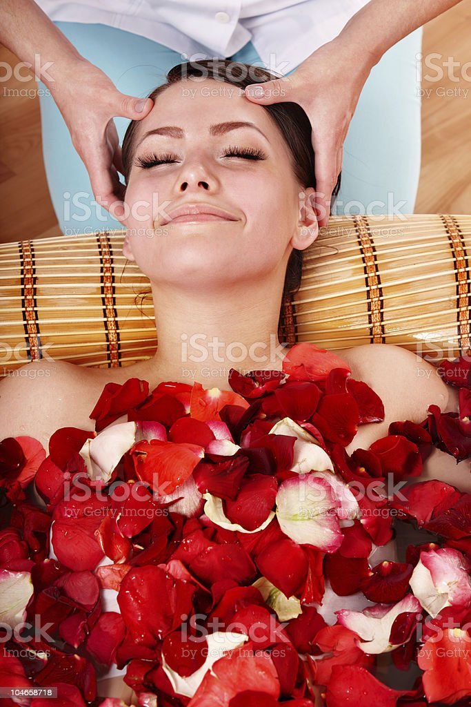 Beautiful girl in jacuzzi with rose petal. royalty-free stock photo