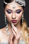 Beautiful girl in image of Arab bride with expensive jewelry