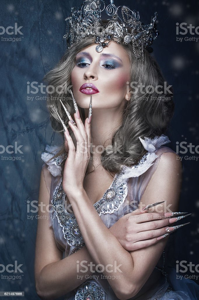 Beautiful girl in image of Snow Queen, creative make-up stock photo