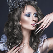 Beautiful girl in image of Snow Queen, creative make-up