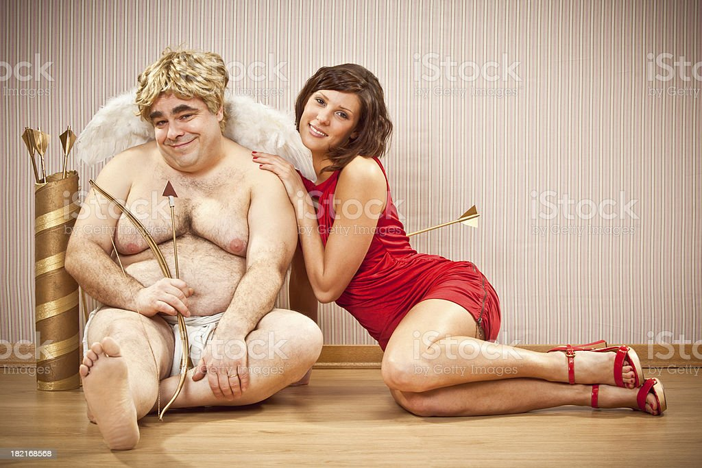 beautiful girl in love with tender cupid stock photo