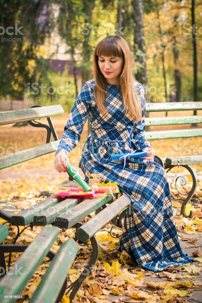 beautiful girl in park autumn stock photo