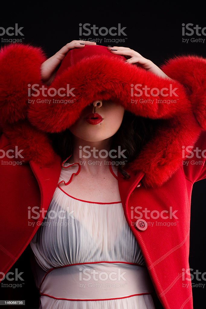 beautiful girl in red fur coat royalty-free stock photo
