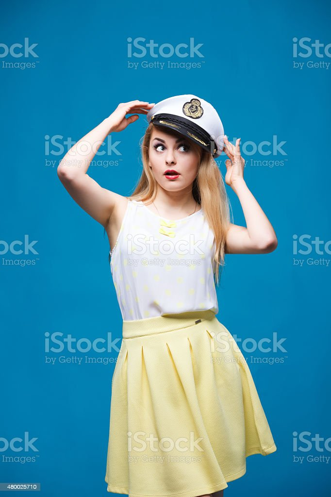 beautiful girl in style of pin-up, Dresses captain cap stock photo
