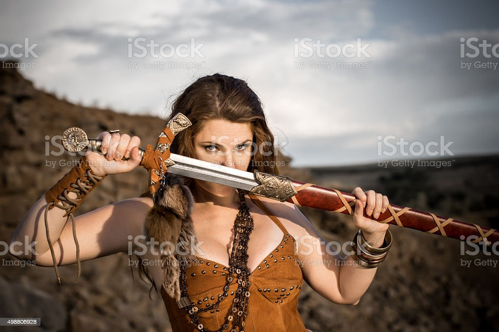 Beautiful girl in the clothes of a Viking. stock photo