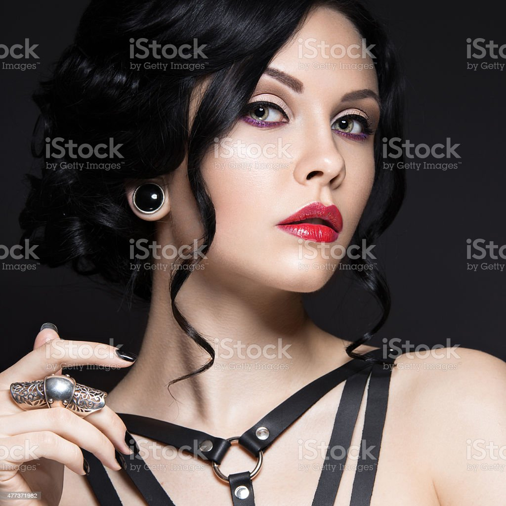 Beautiful Girl in the Gothic style with leather accessories and stock photo