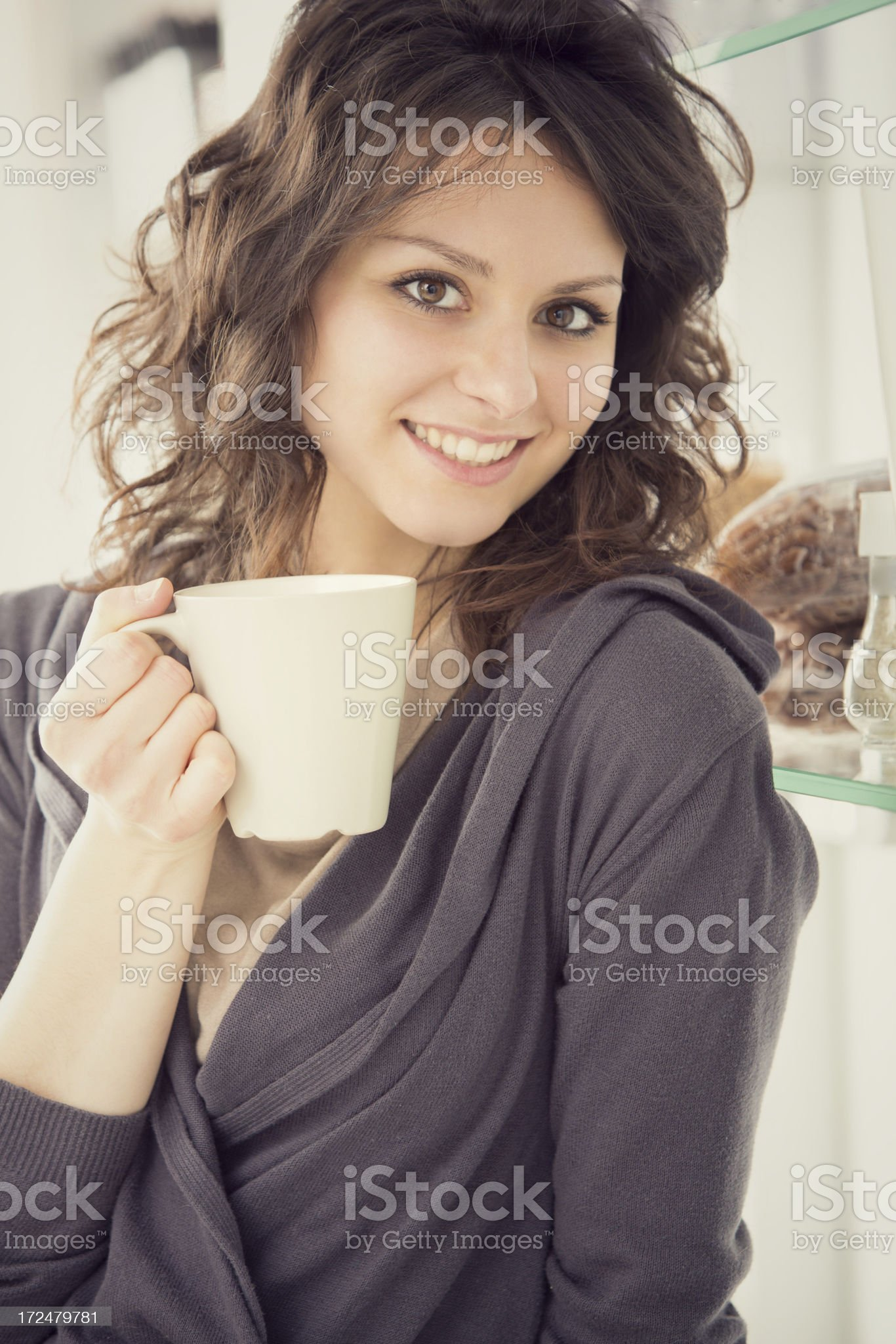 Beautiful girl in the kitchen portrait with cell phone royalty-free stock photo