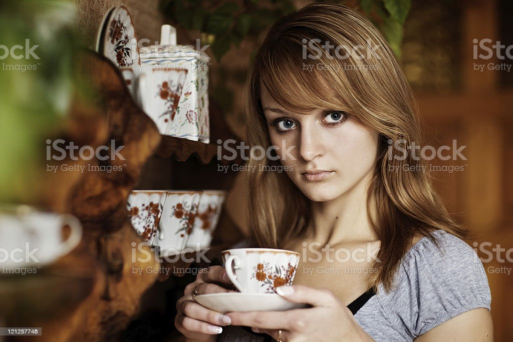 Beautiful girl in the kitchen with a cup of tea royalty-free stock photo