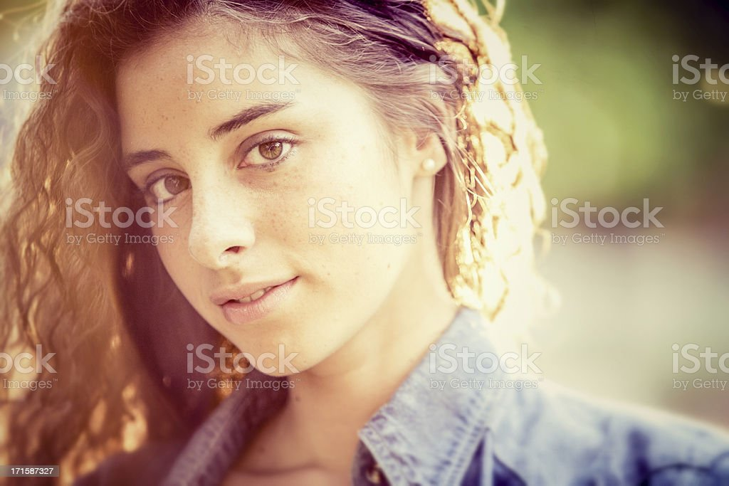 Beautiful girl in the park at sunset stock photo