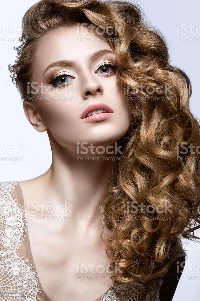 Beautiful girl in wedding image with barrette in her hair stock photo