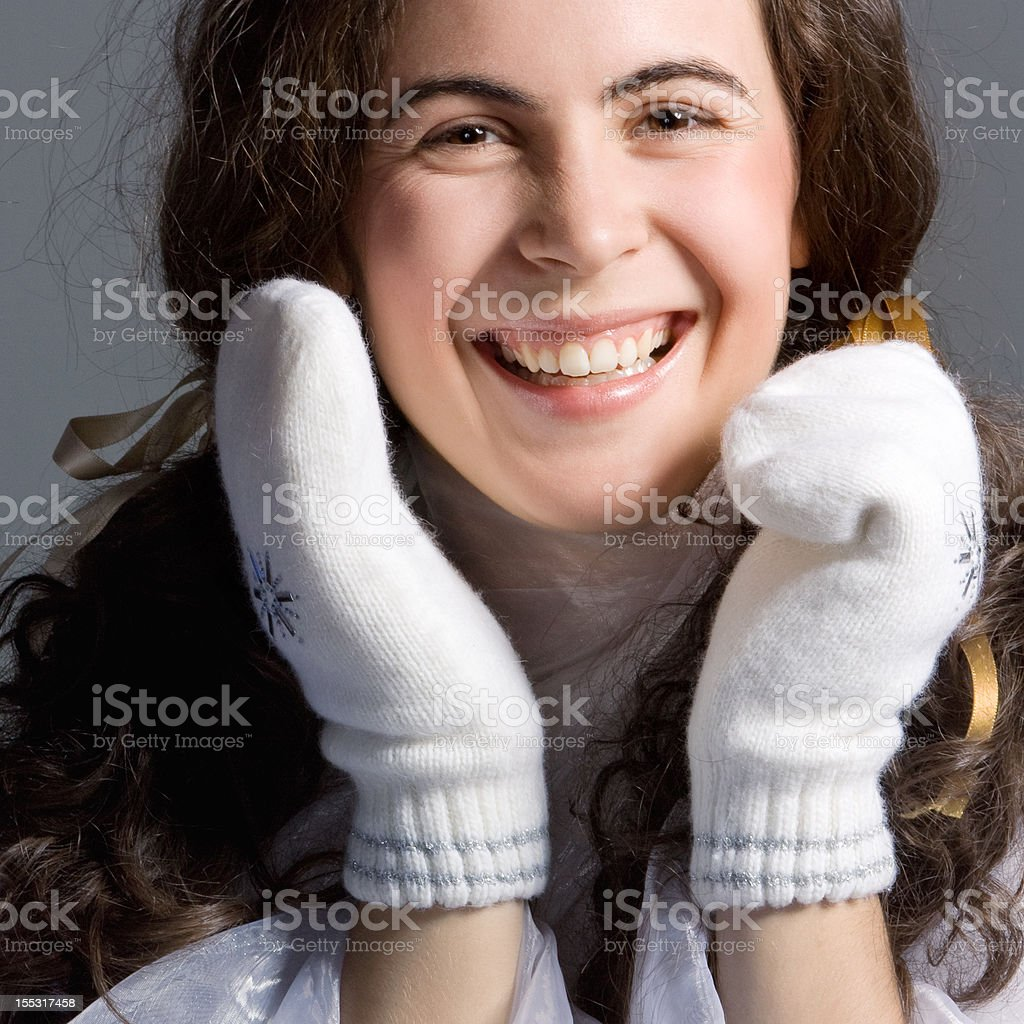beautiful girl in white mittens. royalty-free stock photo