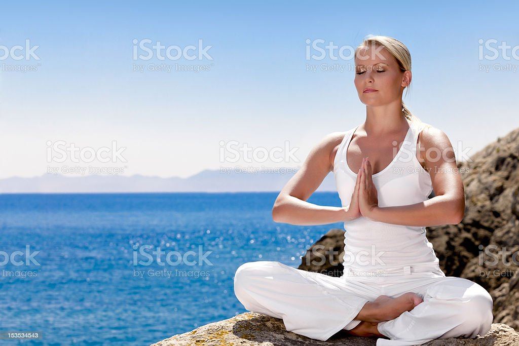 Beautiful girl in yoga pose royalty-free stock photo