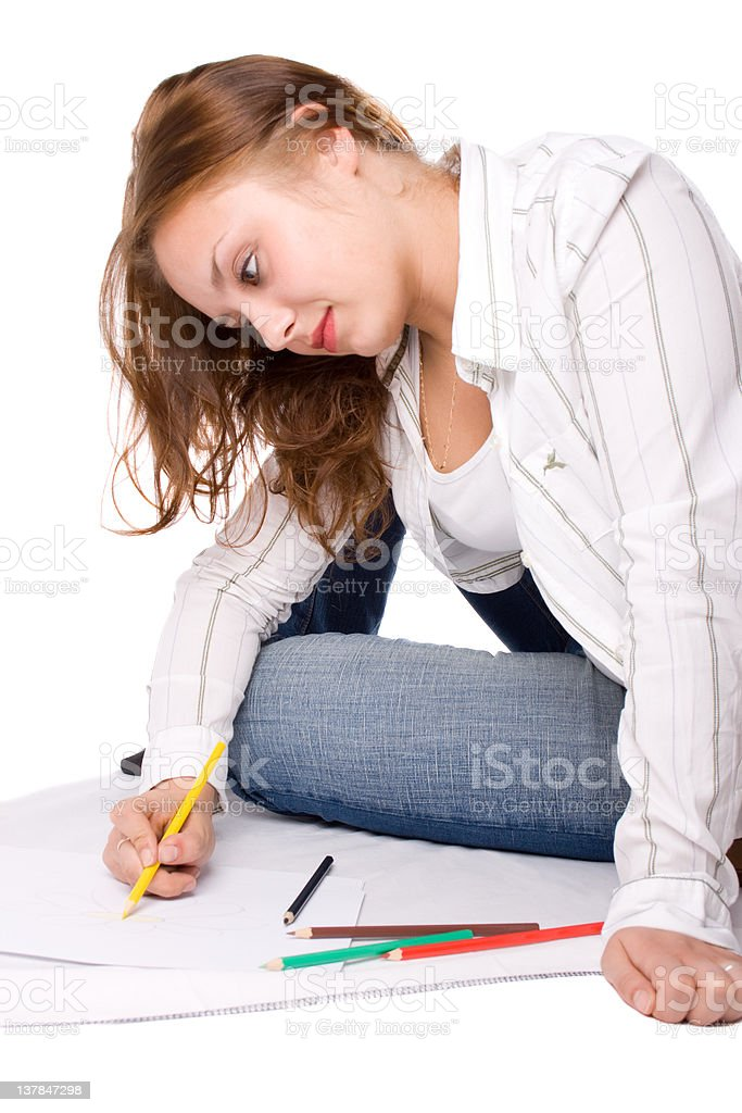 Beautiful girl is drawing with crayons royalty-free stock photo