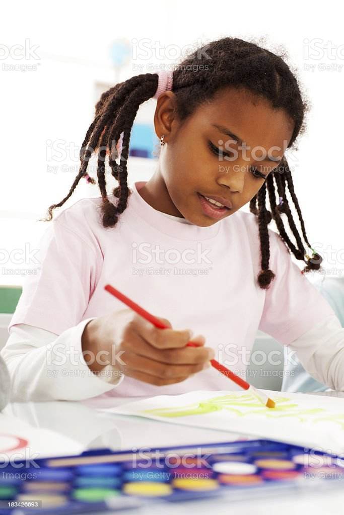 Beautiful girl is drawing with watercolors. royalty-free stock photo