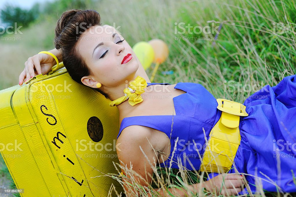 beautiful girl is resting on a green grass royalty-free stock photo