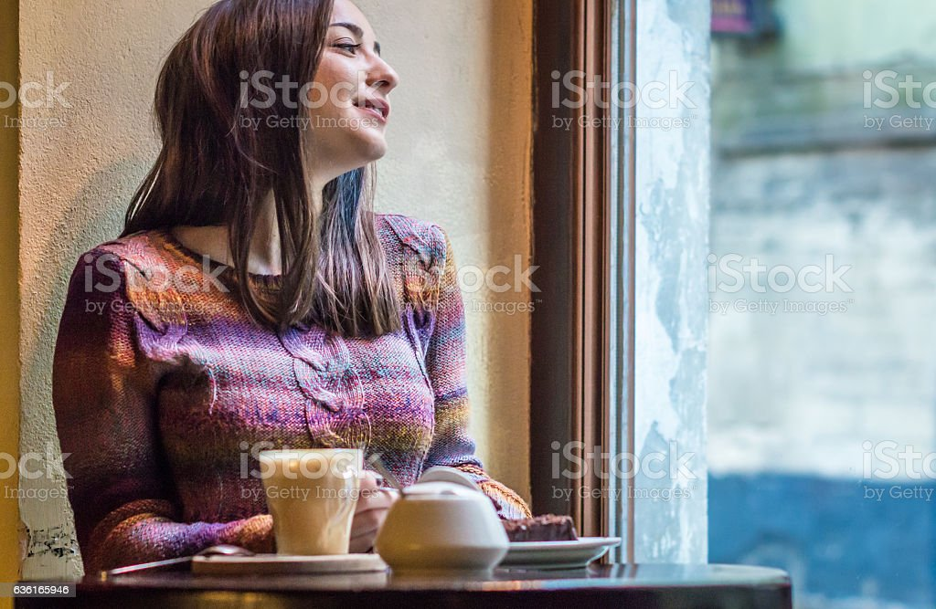 beautiful girl look out the window stock photo
