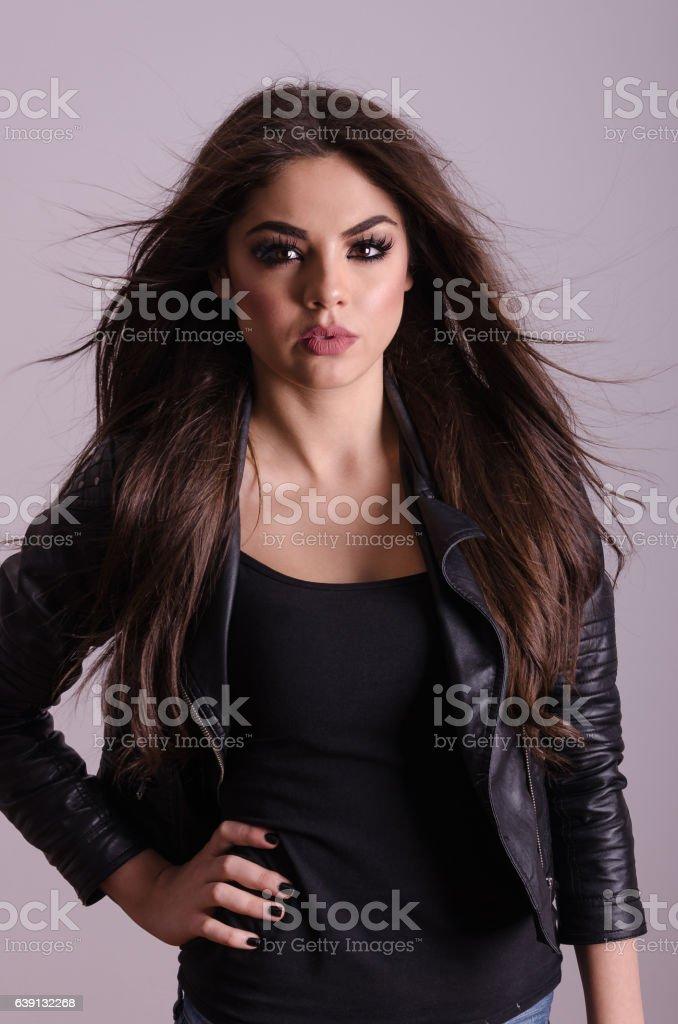 Beautiful girl model posing in the studio. Modern woman portrait stock photo