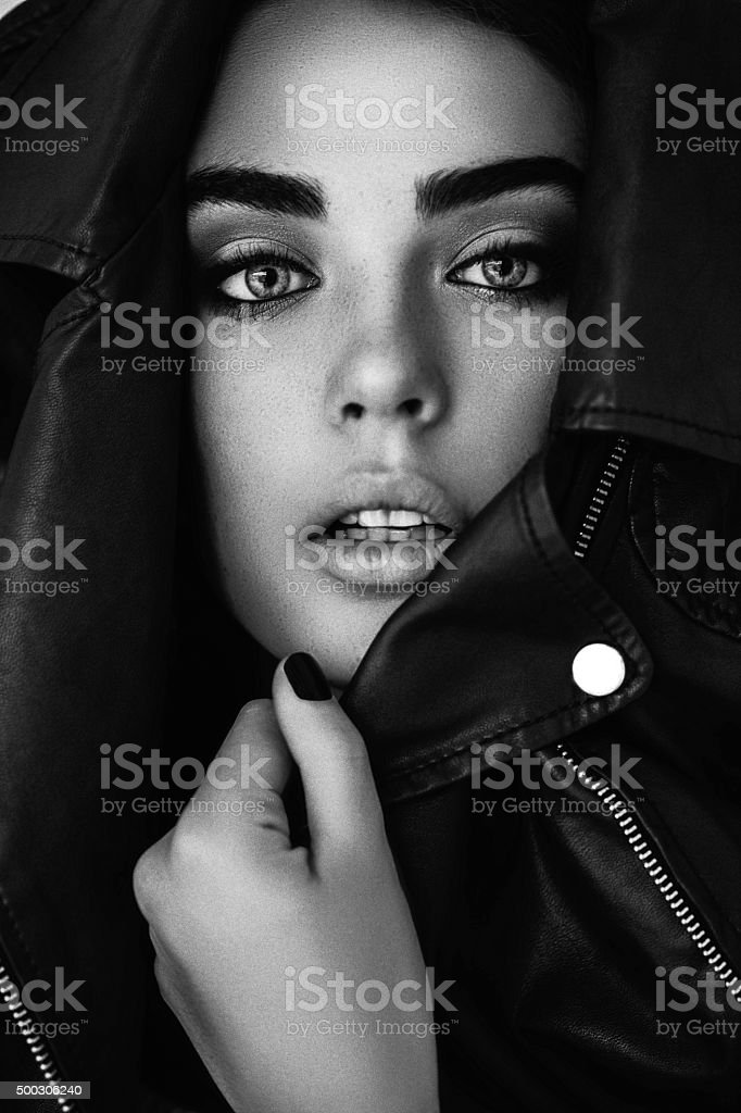 Beautiful girl muffle in a leather jacket stock photo