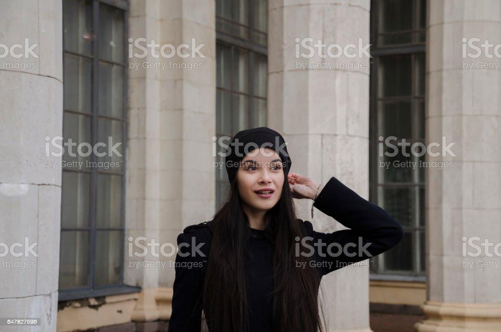 beautiful girl near columns stock photo