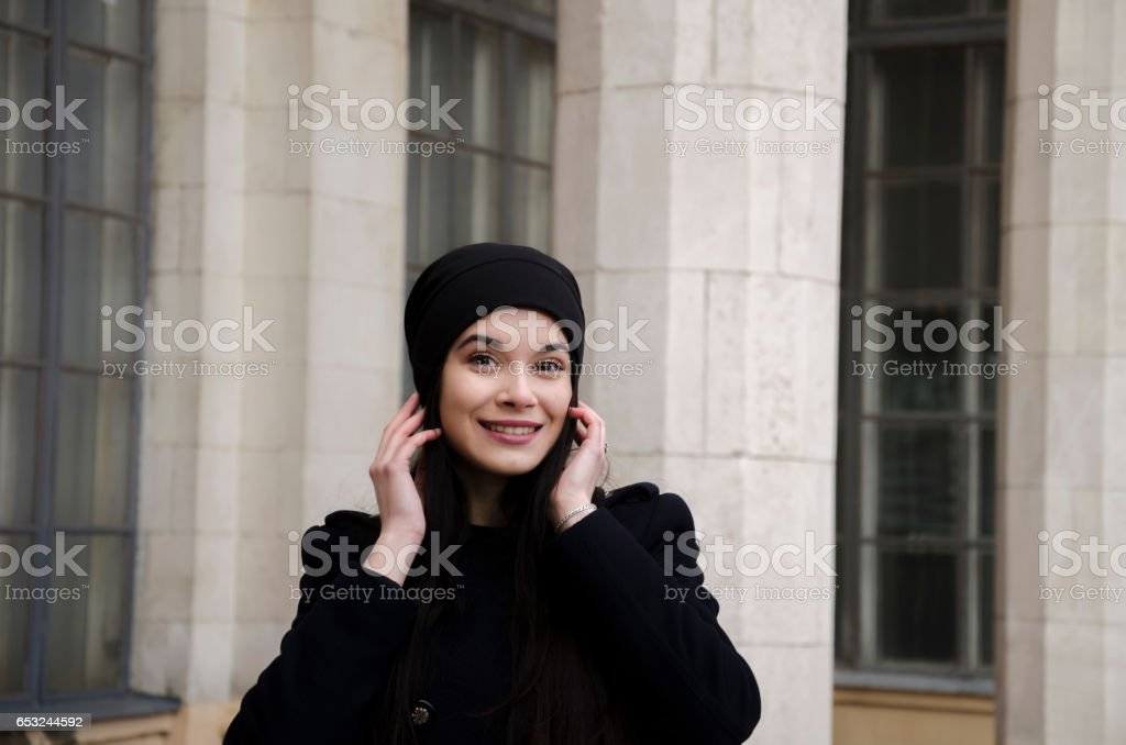Beautiful girl near the columns stock photo