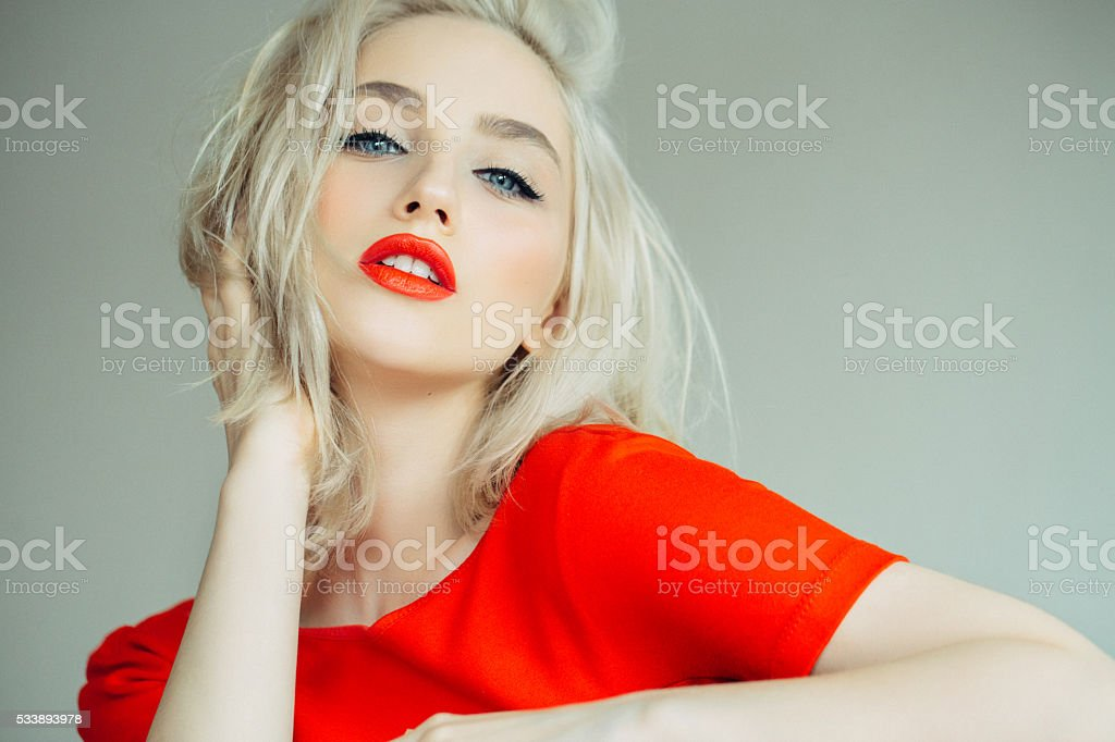 Beautiful girl on a bright red background stock photo