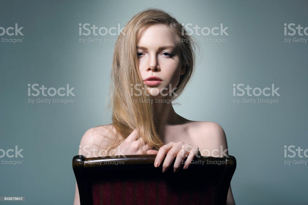 Beautiful girl on a chair close up. stock photo
