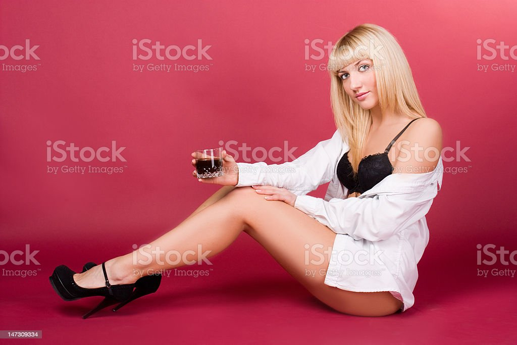 Beautiful girl on a red background royalty-free stock photo