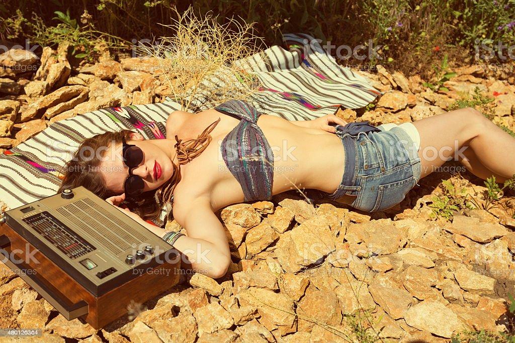 Beautiful girl on a stony beach stock photo