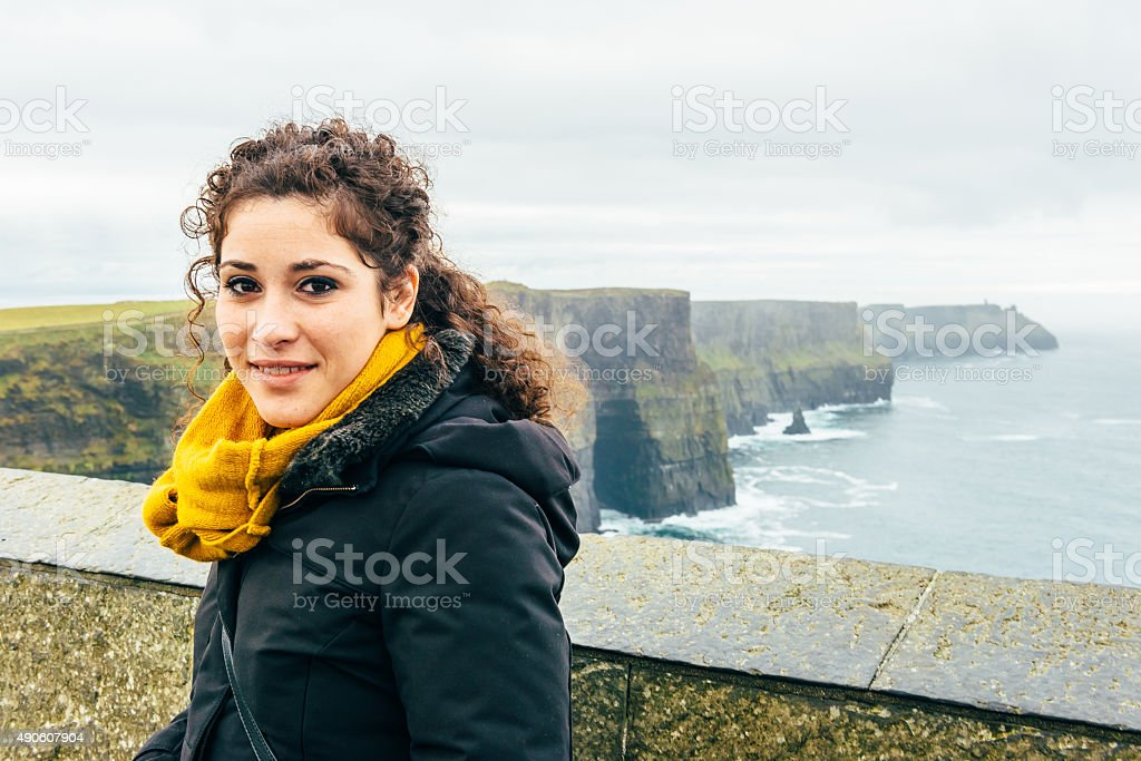 beautiful girl on a trip to the cliff of moher stock photo