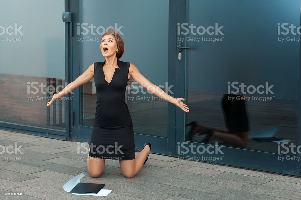 Beautiful girl on her knees and screaming for joy. stock photo