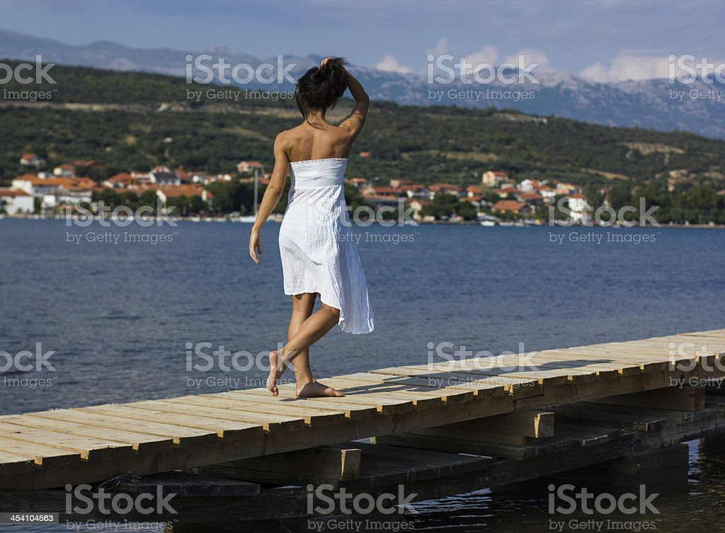 Beautiful girl on the beach royalty-free stock photo