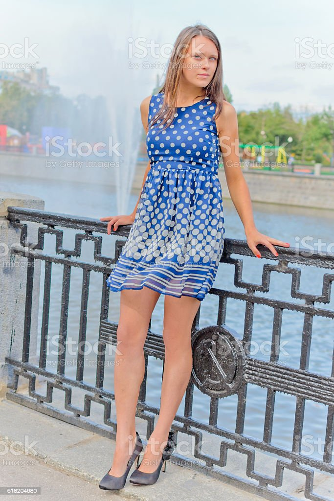 Beautiful girl on the embankment of the Moscow River stock photo