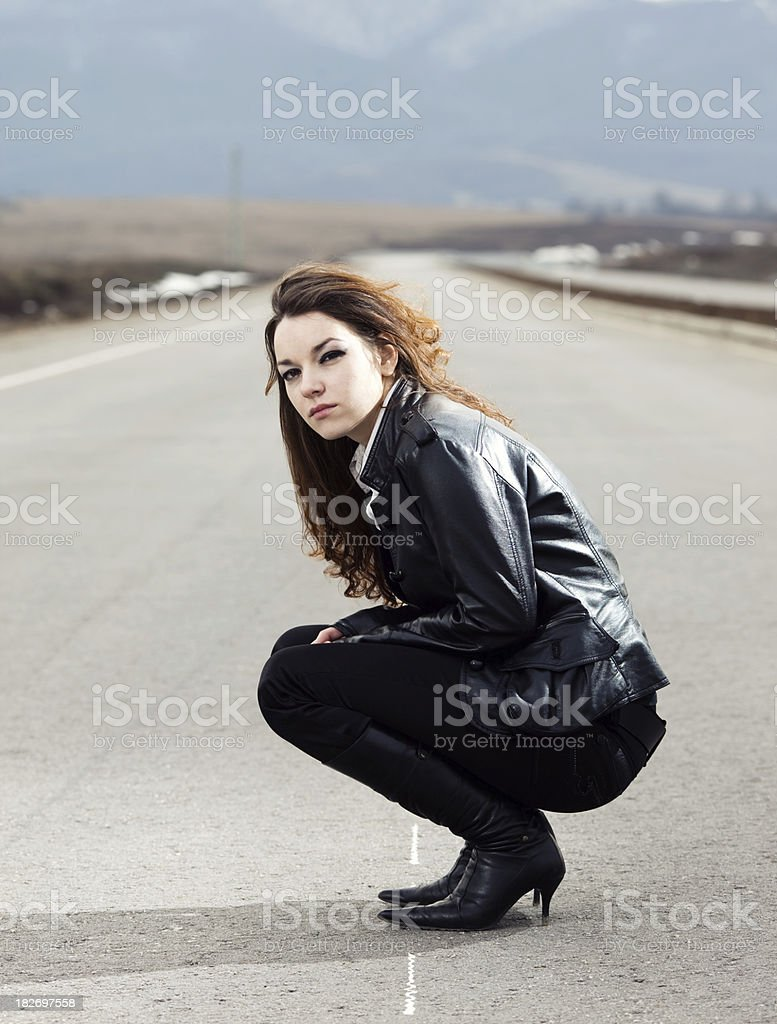 Beautiful girl on the highway royalty-free stock photo