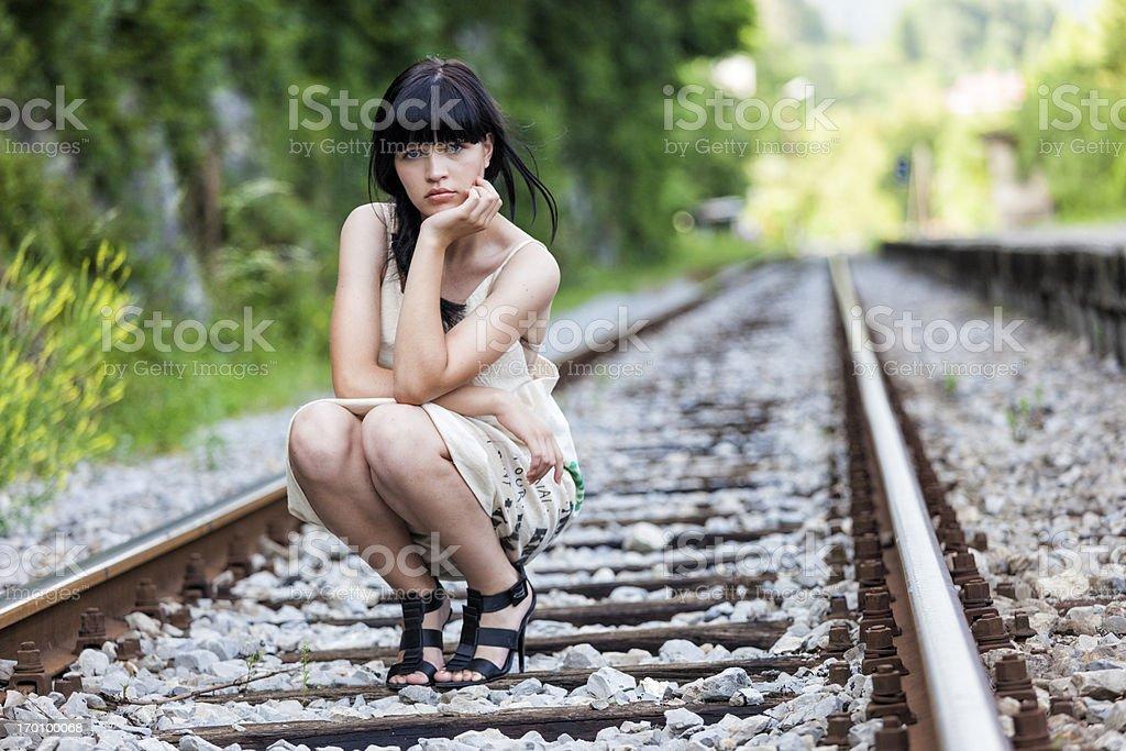 Beautiful girl on the railway tracks royalty-free stock photo