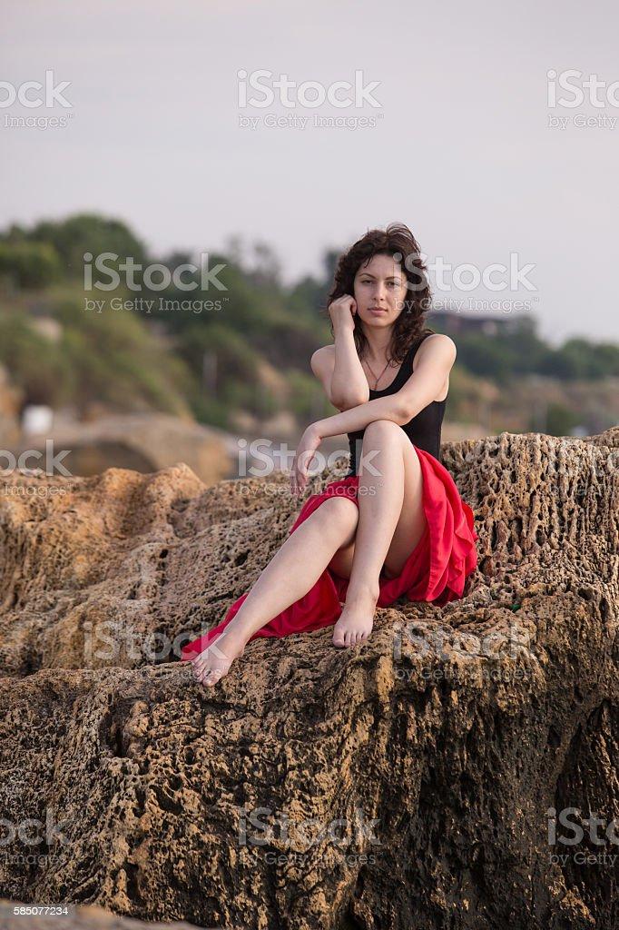Beautiful girl on the rock royalty-free stock photo