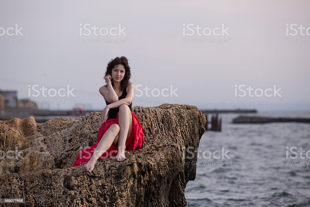 Beautiful girl on the rock royalty-free stock photo