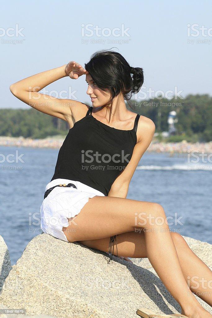 Beautiful Girl on the Rocks royalty-free stock photo