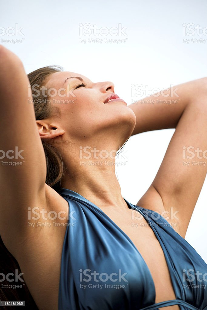 Beautiful girl plays with her hair stock photo