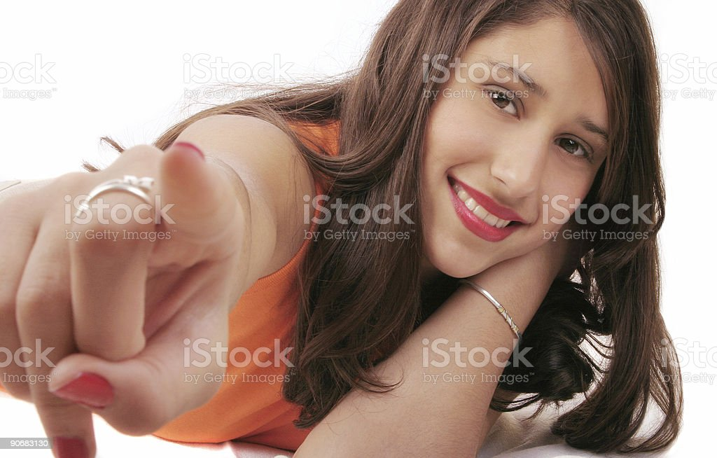 Beautiful girl pointing at you 1 stock photo
