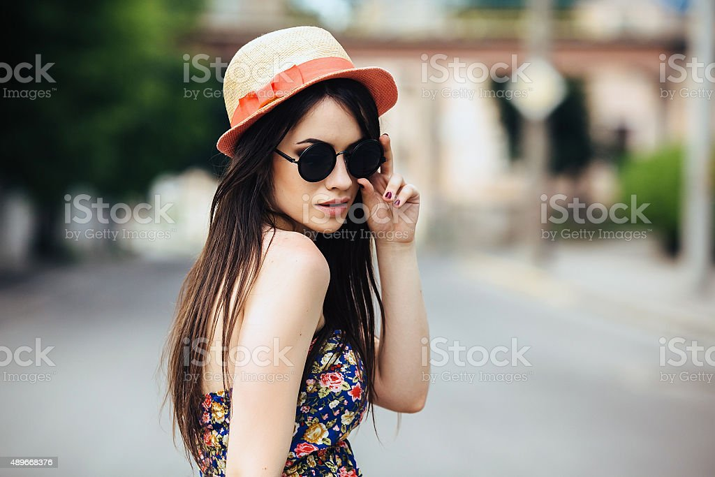 beautiful girl poses for camera in the city stock photo