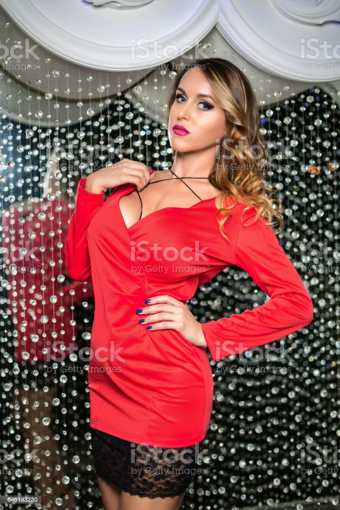 beautiful girl posing in a red dress stock photo