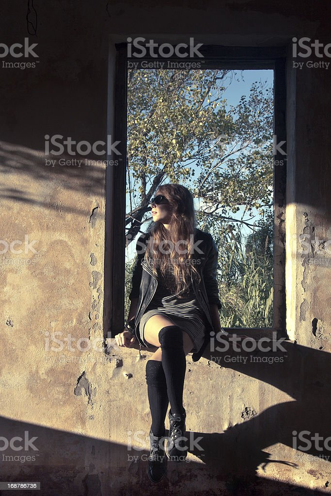 Beautiful girl posing in an old house stock photo