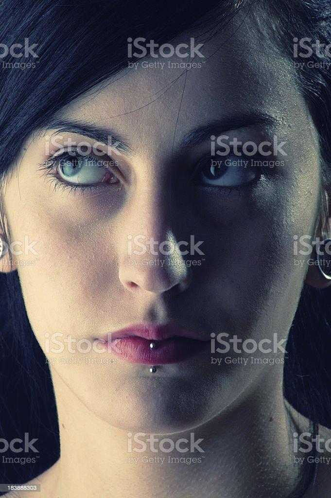 beautiful girl posing in studio on black background royalty-free stock photo