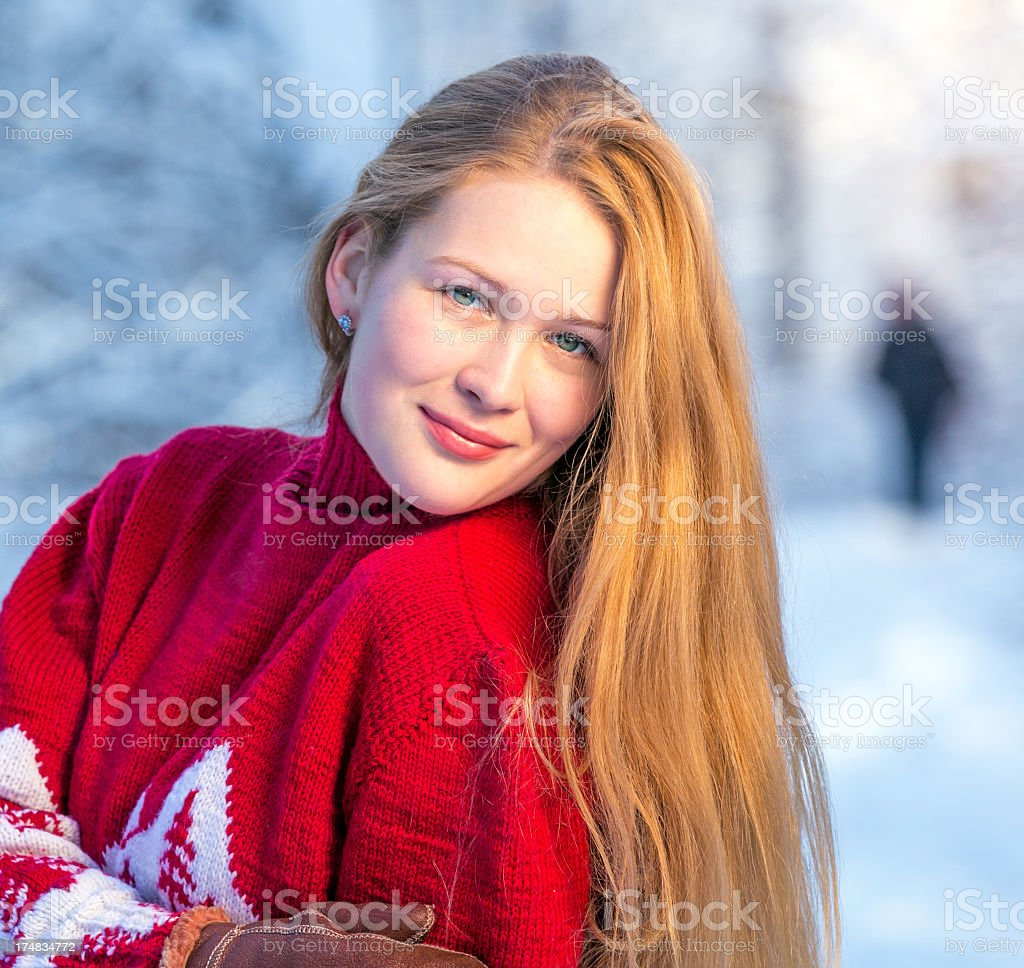 Beautiful girl posing in winter forest royalty-free stock photo