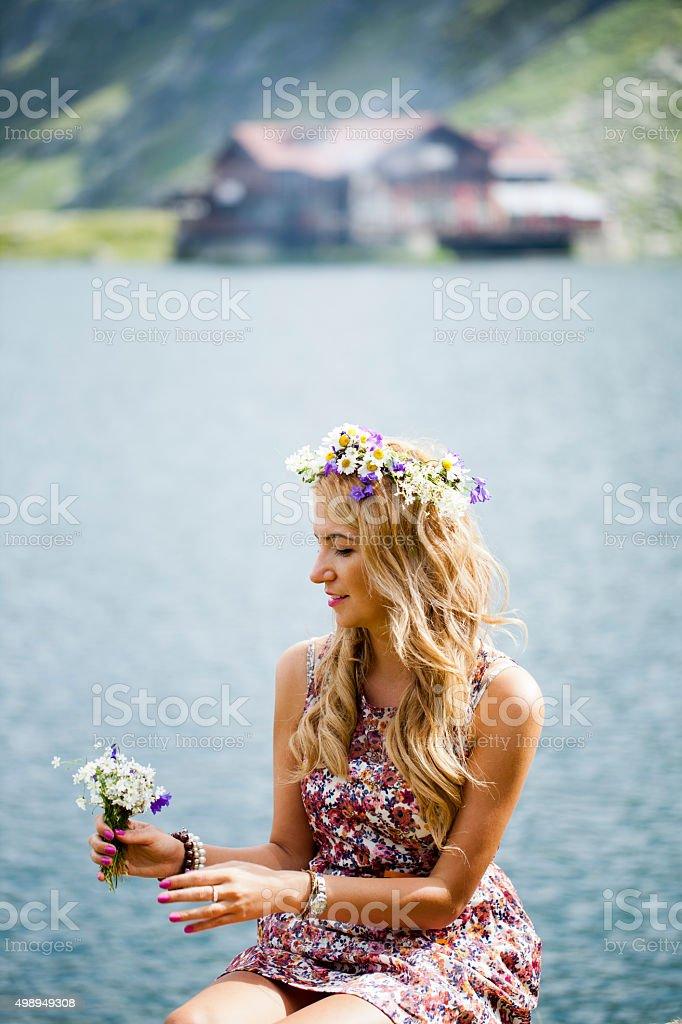 Beautiful girl posing on mountain edge stock photo