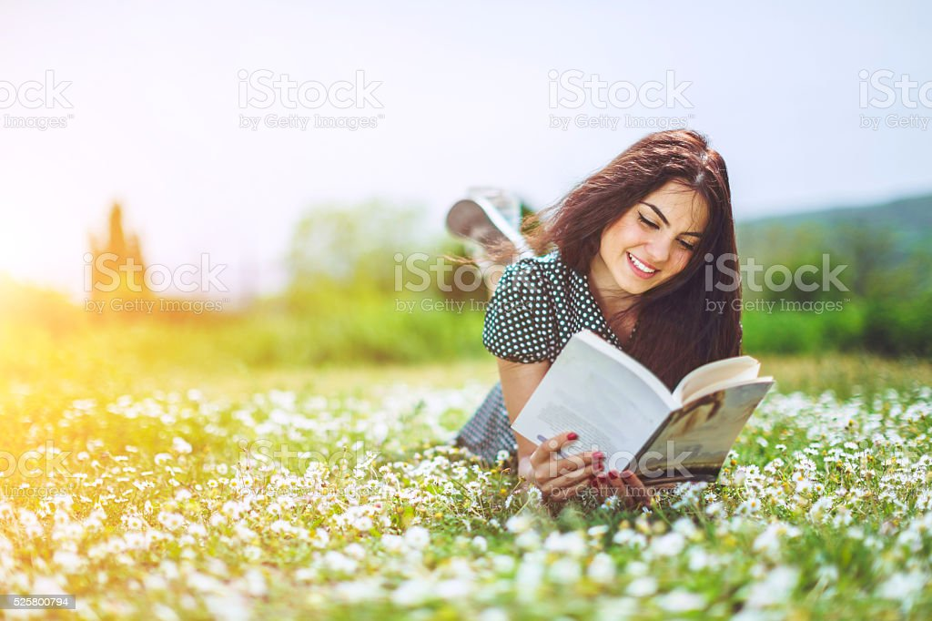 beautiful girl reading a book stock photo