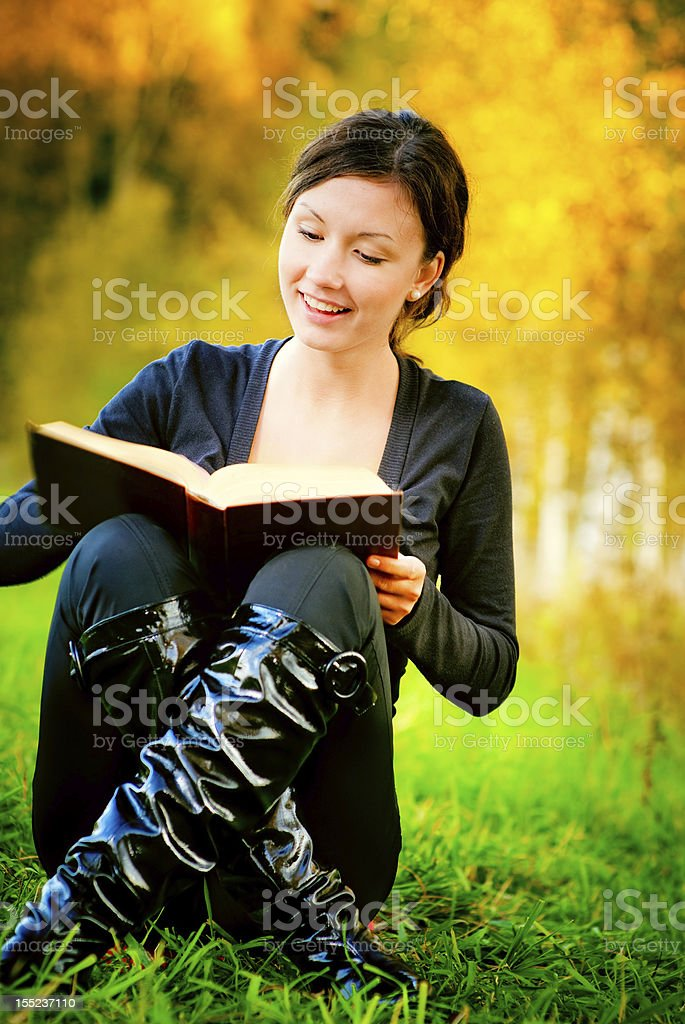 Beautiful girl reads book royalty-free stock photo