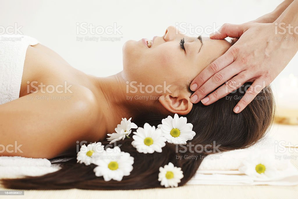 Beautiful girl receiving a head massage at spa royalty-free stock photo